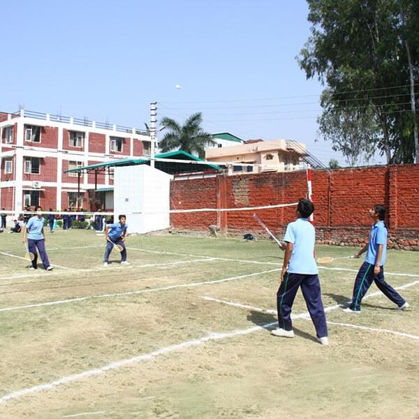 students playign in universal academy dehradun playground